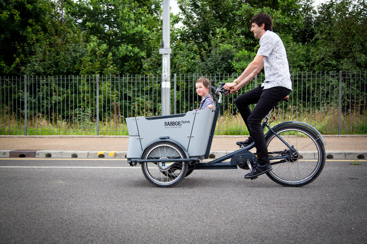 Father and daughter riding cargo bike
