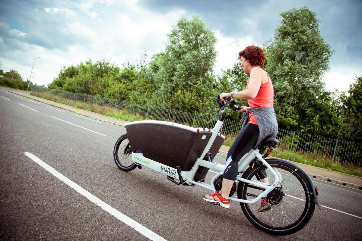 woman riding cargo bike