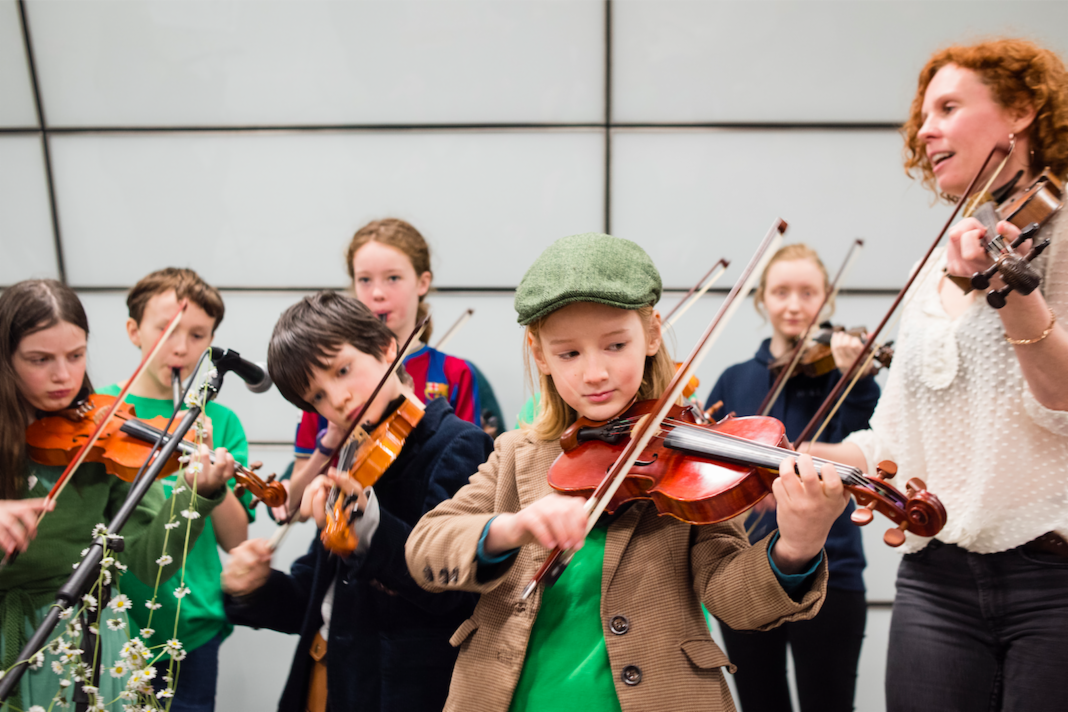 A school showcase their musical skills on the netwoork