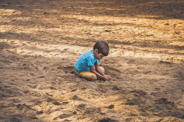 boy-playing-in-sand