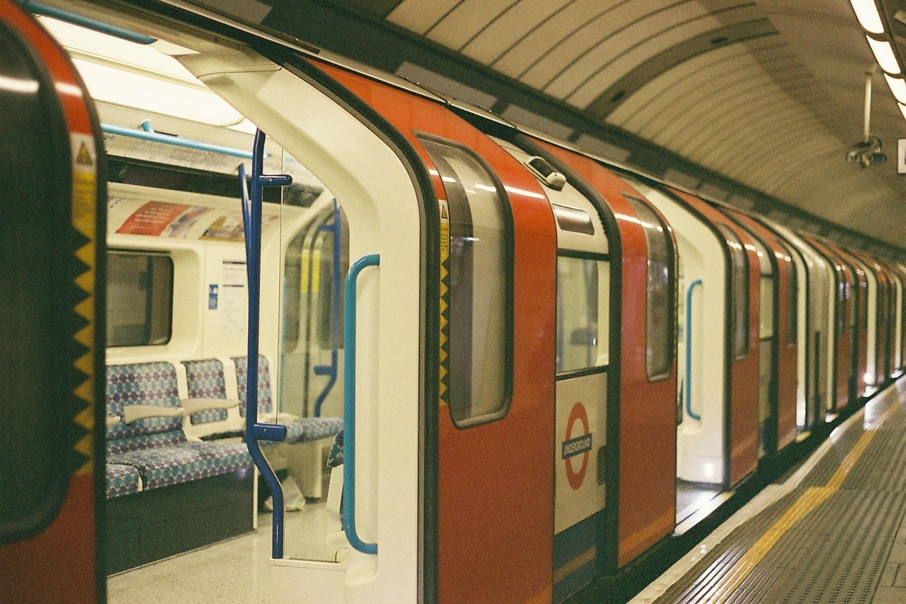 The tube stationary at the platform with the doors open