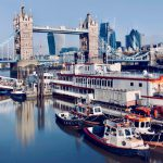 Boats in front of London Bridge on the Thames river