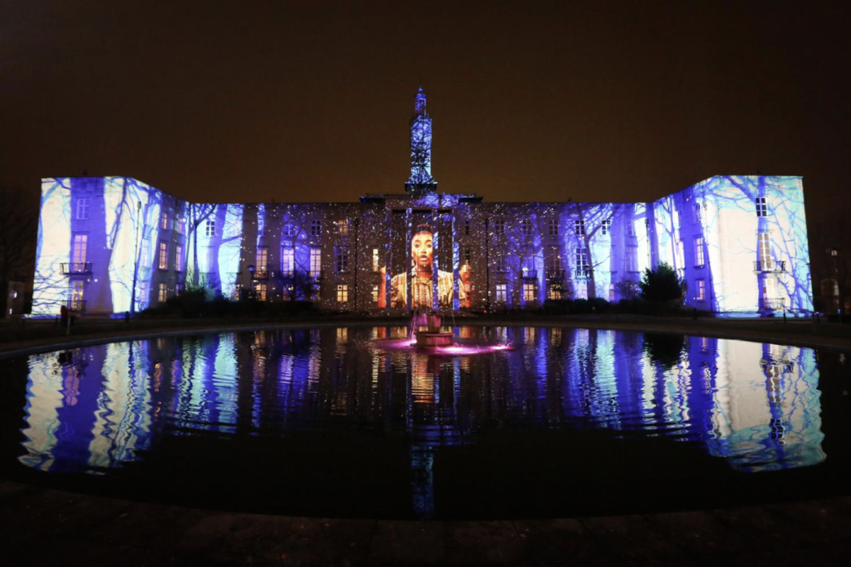 Light show against building in Walthamstow as part of Waltham Forest Borough of Culture