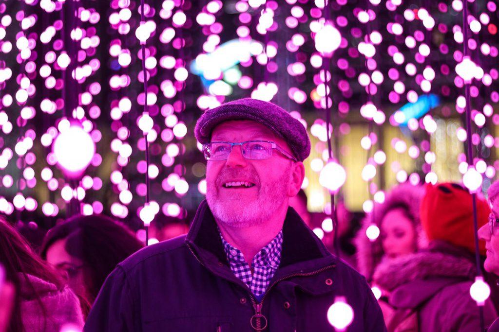 Man enjoying Canary Wharf Winter Lights festival