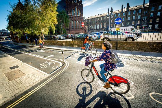 People cycling Santander Cyclies in London
