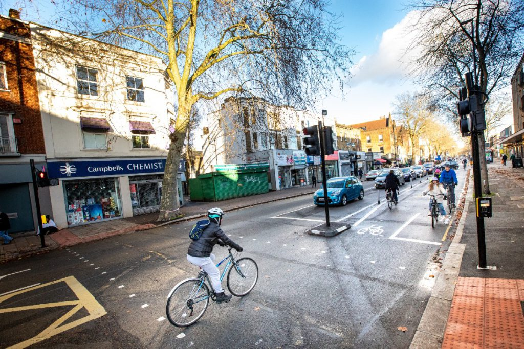People cycling along Cycleway 9 on Chiswick High Road