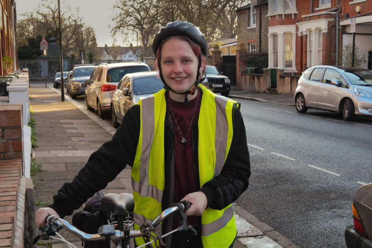 Woman in a high vis jacket with her cycle
