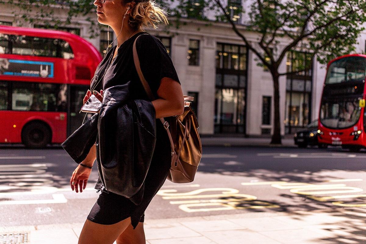 Woman walking down a road in London