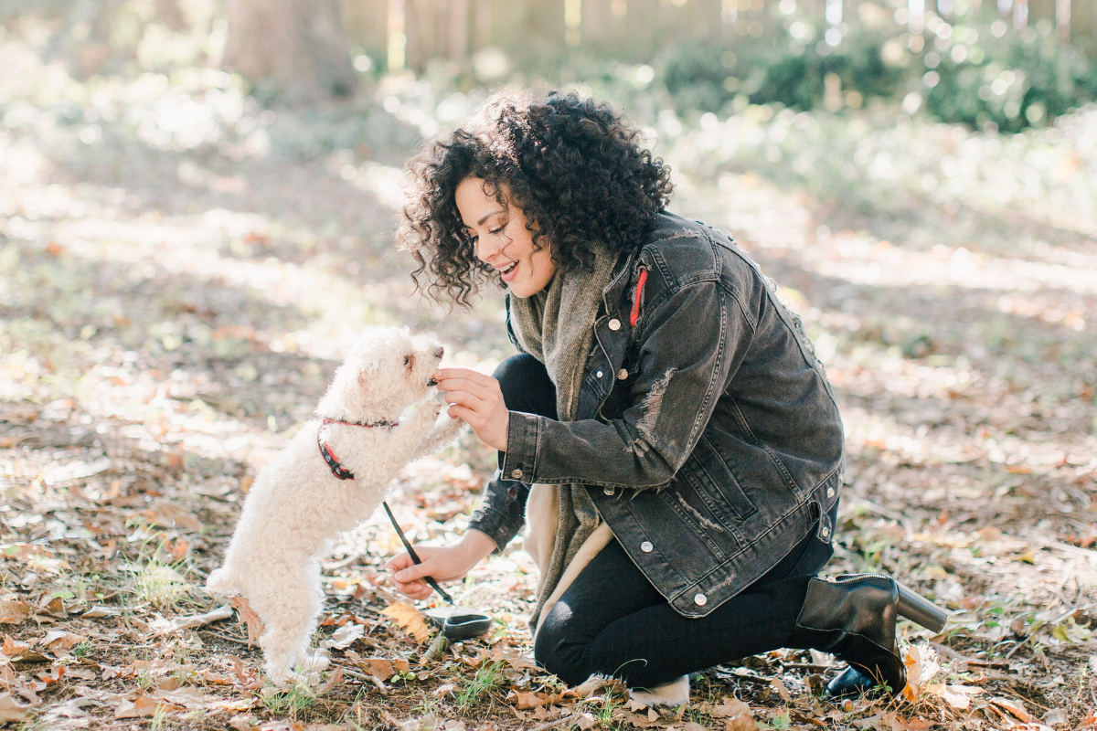 Woman and dog in forest
