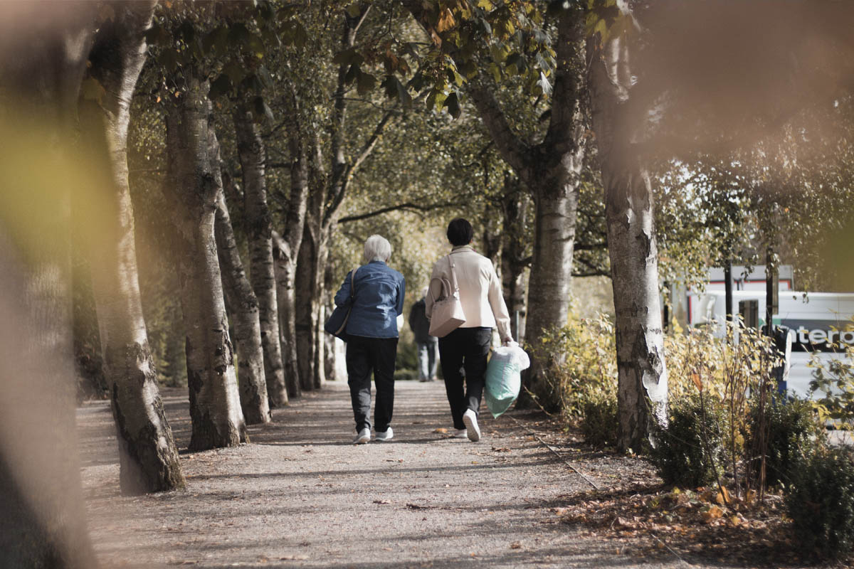 Two women walking through a park