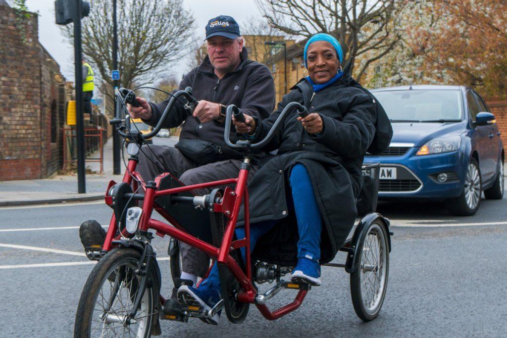 People using a side-by-side bike