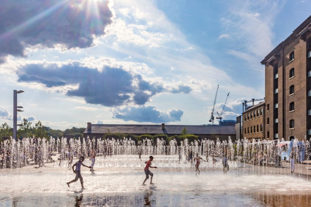 Children playing in the fountains at Granary Square