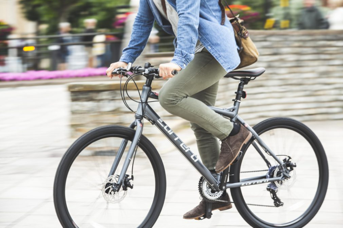 Person riding a hybrid cycle
