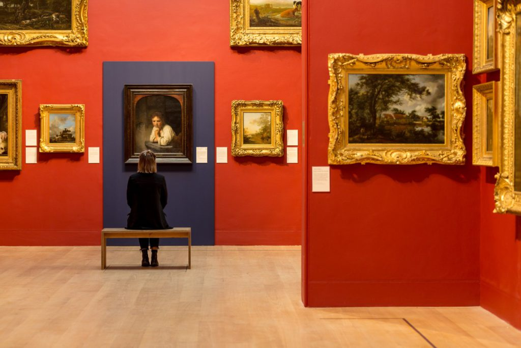 Woman sitting in front of a painting at Dulwich Picture Gallery