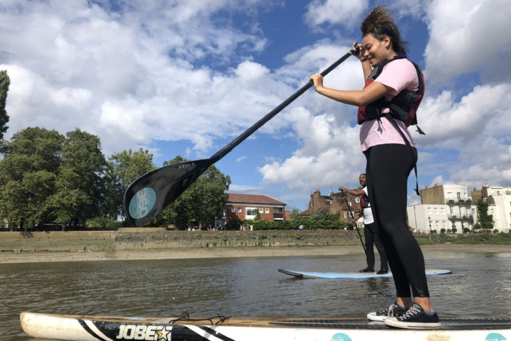 Family paddle boarding in London