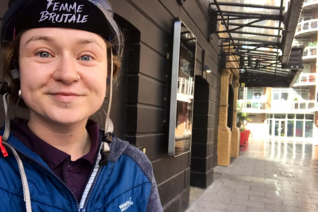 Aisling on their commute outside the theatre