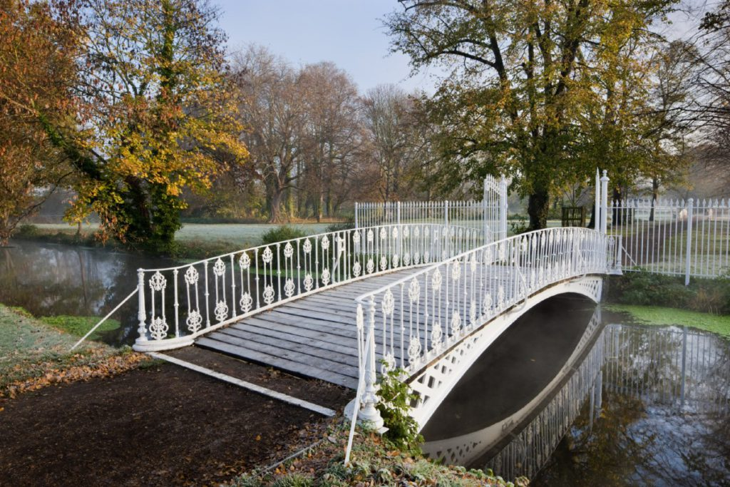 White iron bridge over the River Wandle at Morden Hall Park