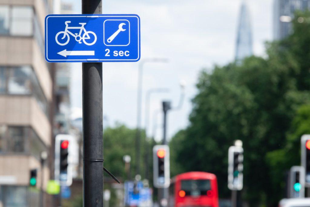 Cycle repair shop street sign