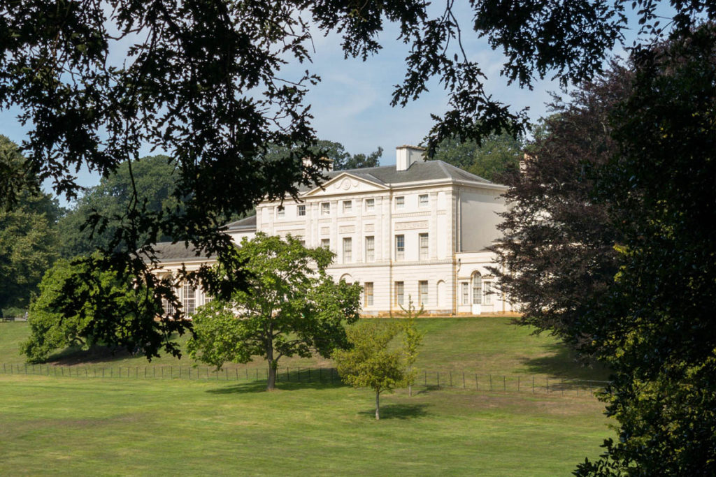 Kenwood house surrounded by trees on a sunny day.
