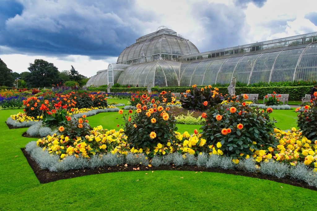 outside of Kew Gardens greenhouse with rose gardens