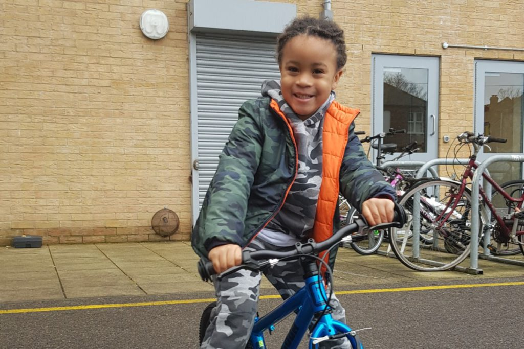 Cairo smiling on his cycle