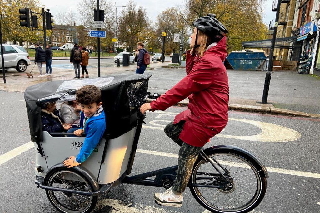 Family cycling on a cargo bike