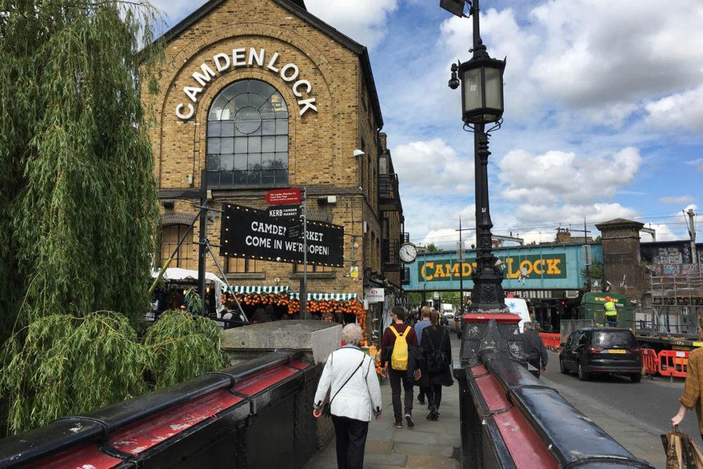 Group of people walking towards Camden Lock.