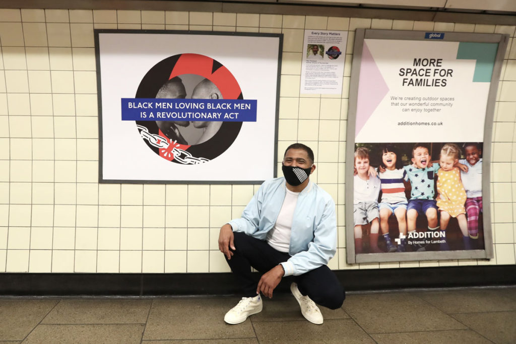 Marc Thomposn with 'Black men loving black men is a revolutionary act' roundel at Brixton station.