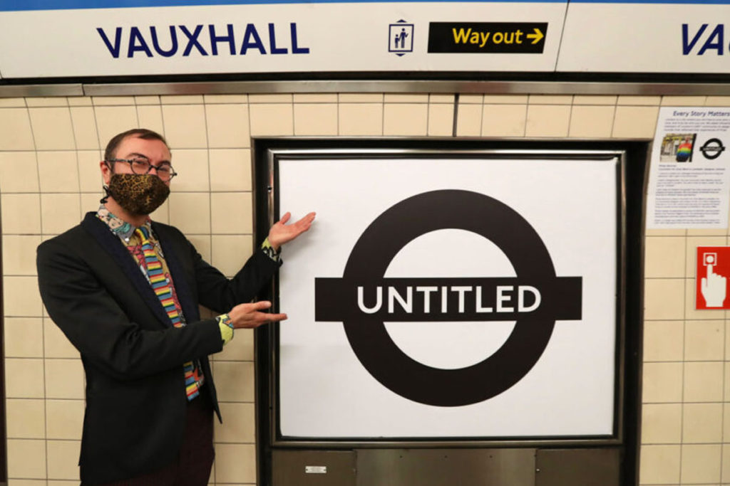 Philip Normal standing next to Untitled roundel at Vauxhall.